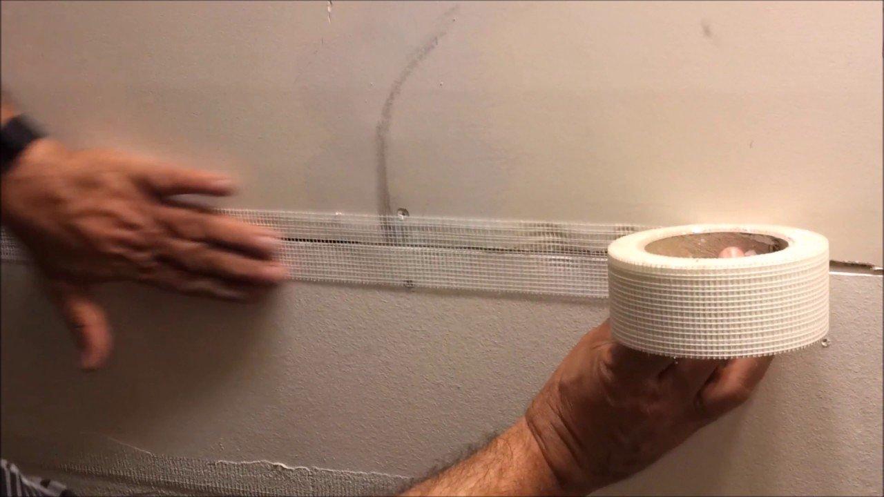 Repair drywall with mesh tape