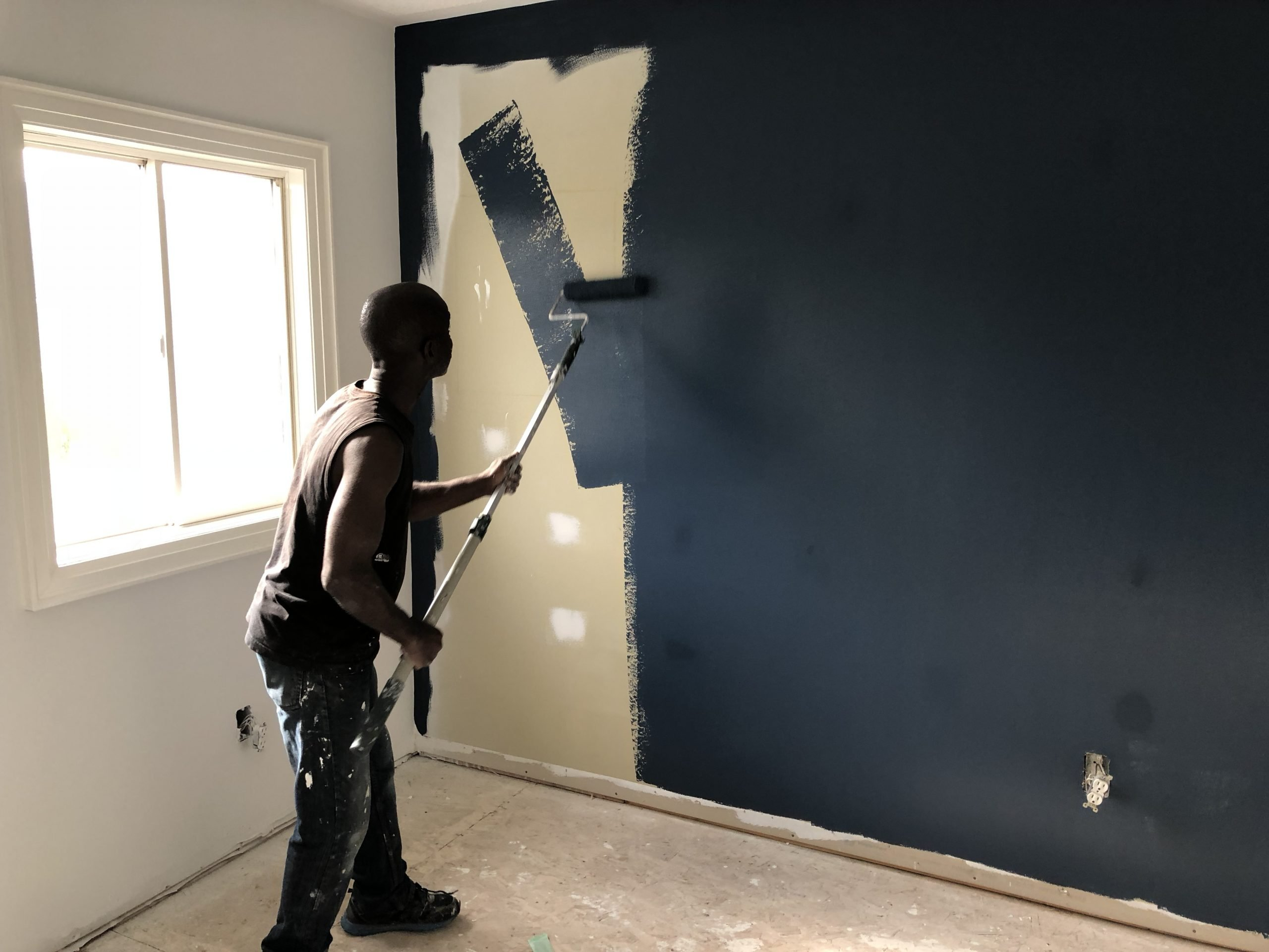 Painting accent walls ideas man rolling wall