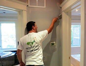 Painting tips, carefully brushing around doorframe
